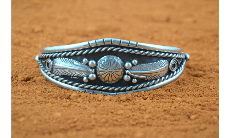 Native american concho and feathers bracelet