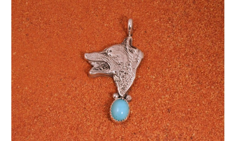 Wolf and turquoise pendant